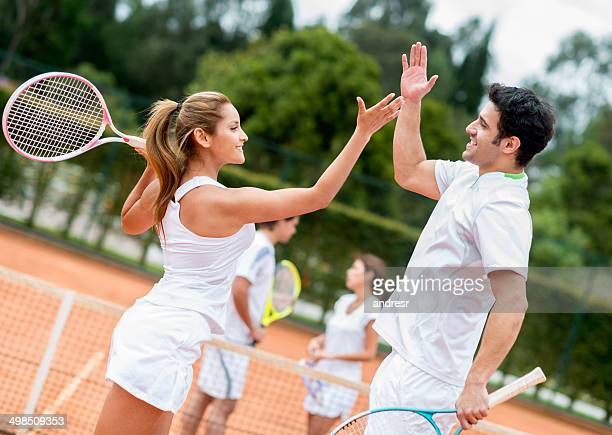 Couple winning a tennis match