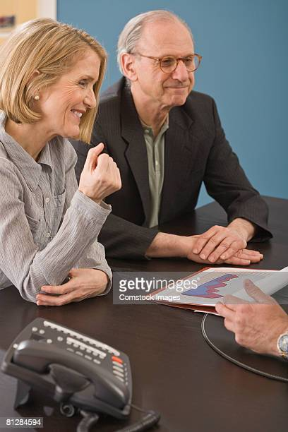 Couple with a bar graph in conversation