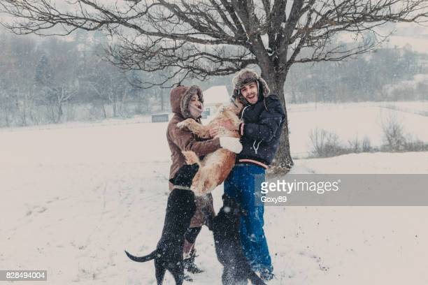 Couple with a dog in winter