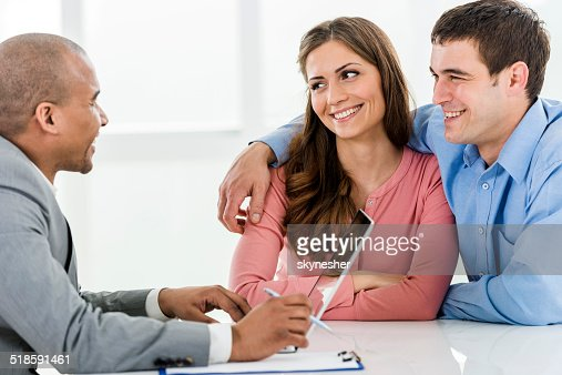 Couple with a financial advisor.