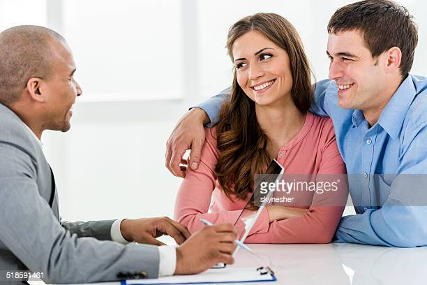 Couple with a financial advisor.