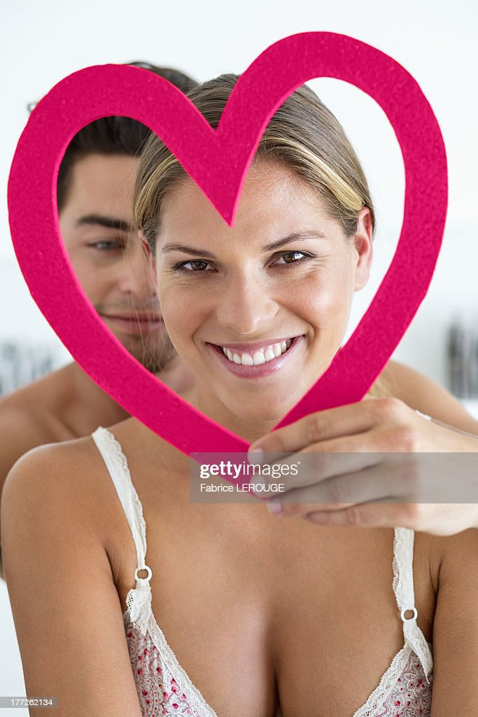 Couple with a heart shape object : Stock Photo