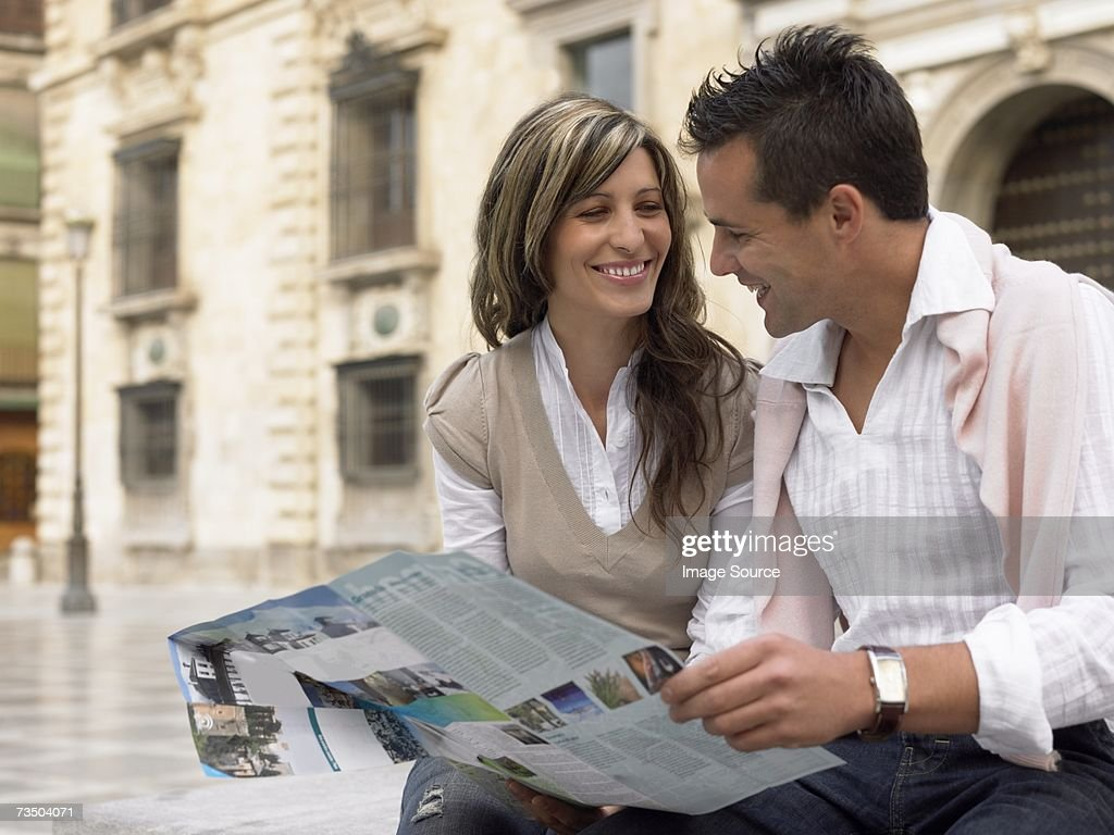 Couple with a map : Stock Photo
