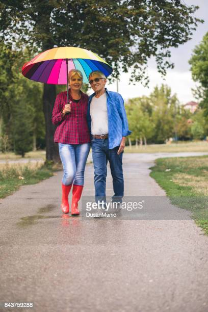 Couple with a rainbow umbrella