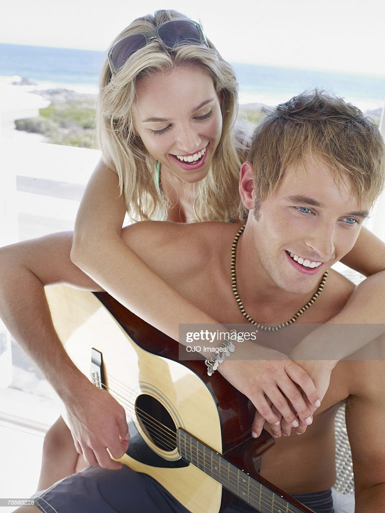 A couple with an acoustic guitar : Stock Photo