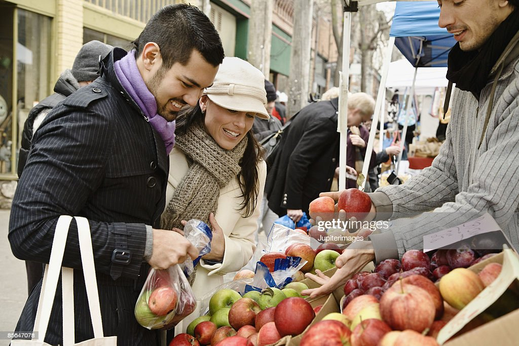 Couple with apples at farmer's market : Stock Photo
