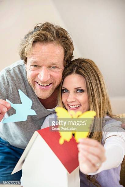 Couple with architectural model and paper figurines