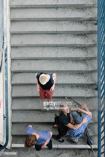 Couple with Bicycle hugging on S-Bahn Stairs