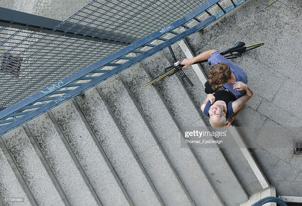 Couple with Bicycle hugging on S-Bahn Stairs : Stock Photo