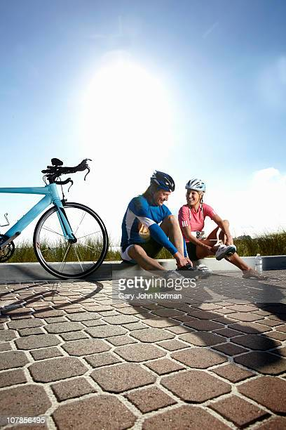 Couple with bicycle relax