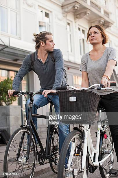 Couple with bicycles on city street