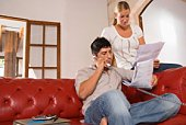 Couple with bills and telephone