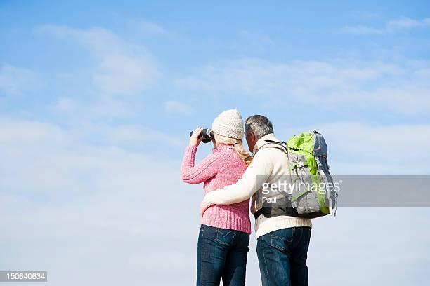 Couple with binoculars outdoors