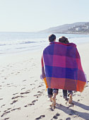 Couple with Blanket on Beach