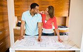 Couple with blueprints