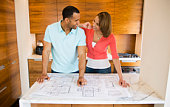 Couple with blueprints