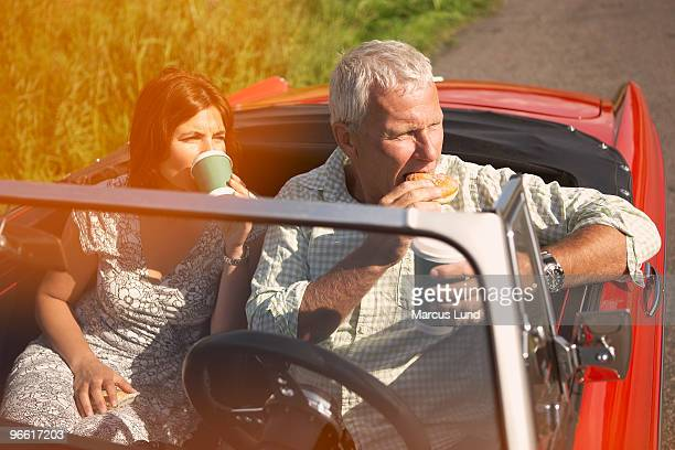 Couple with car, coffee break