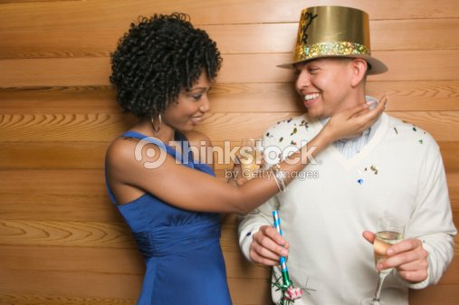 couple with champagne man wearing happy new year hat stock photo
