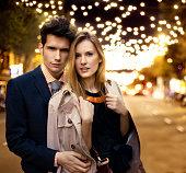 Couple with Christmas lights