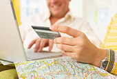 Couple with credit card making vacation purchase online