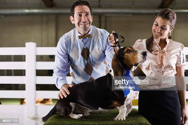 Couple with dog at a dog show