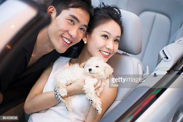 Couple with Dog in Convertible
