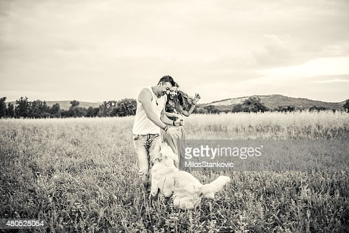 Couple with dog in nature : Stock Photo