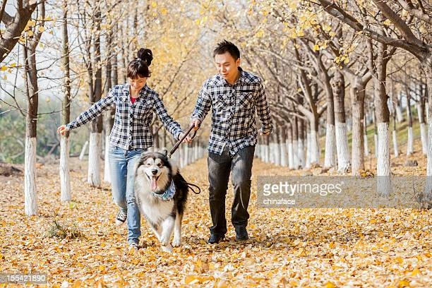 couple with dog outdoor