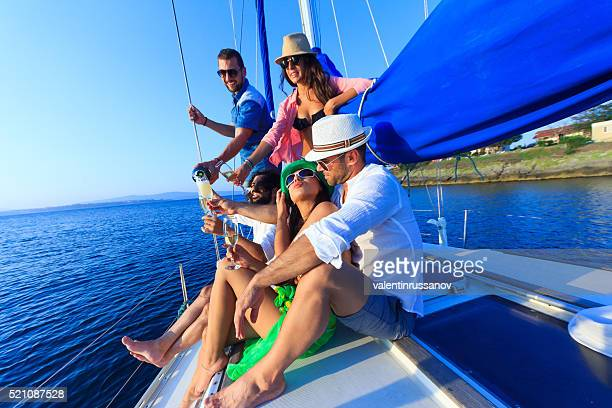 Couple with  friends having fun on sailboat