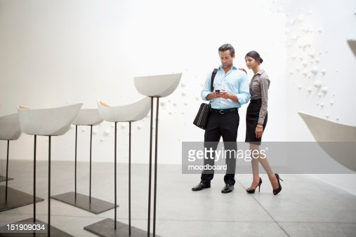 Couple with Glazed ceramics boats in art gallery