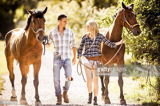 Couple with horses.