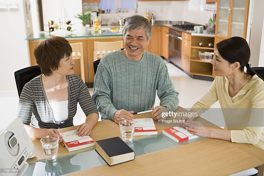 Couple with language teacher : Stock Photo