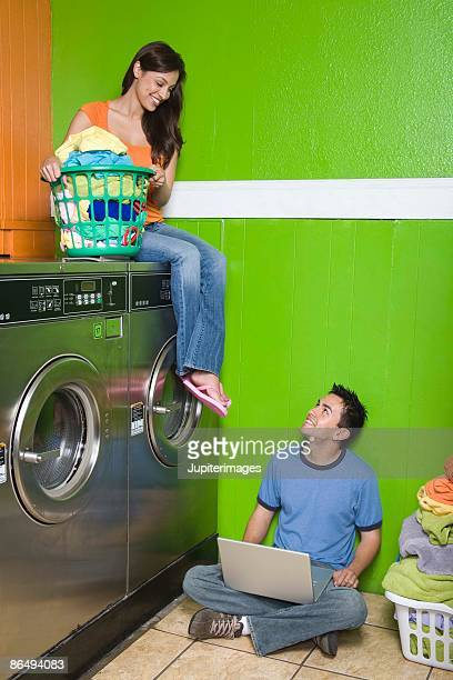 Couple with laptop computer and laundry
