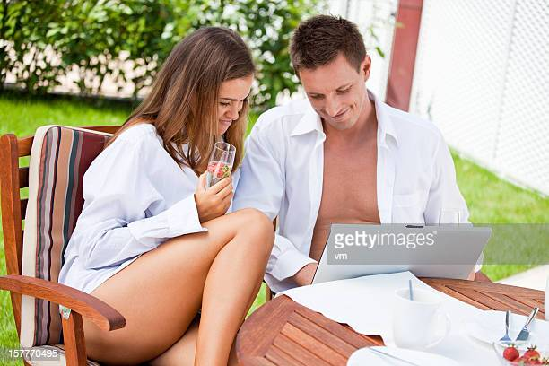 Couple with laptop having fun outdoor