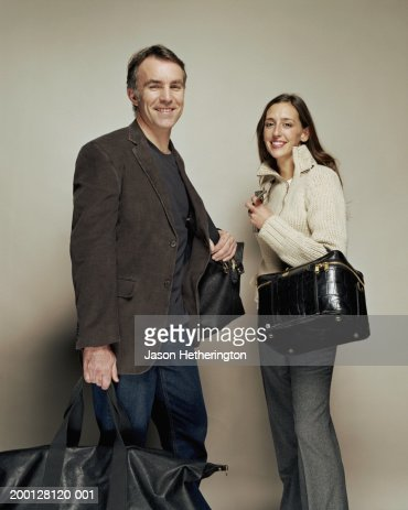 Couple with luggage, smiling, portrait