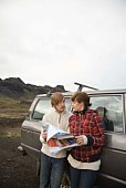 Couple with map by truck, Iceland
