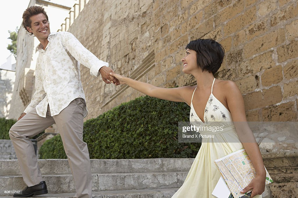 Couple with map holding hands : Stock Photo