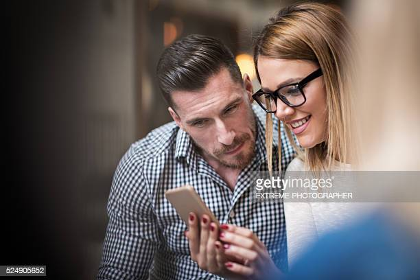 Couple with mobile phone in the coffee shop