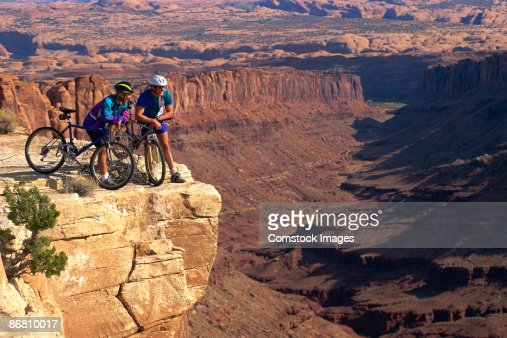 Couple with mountain-bikes on lookout