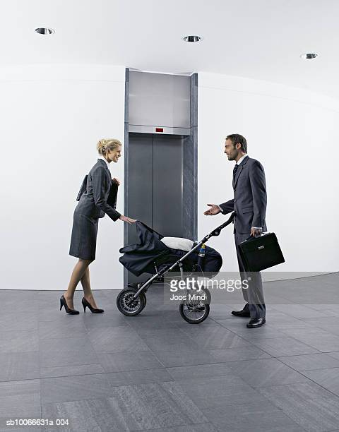 Couple with pram in office lobby