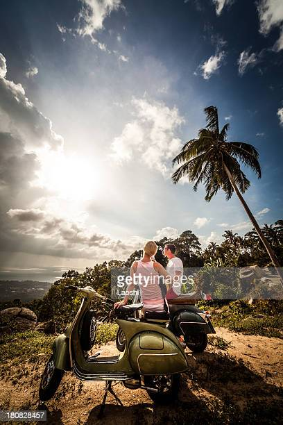 Couple with retro bike on vacation