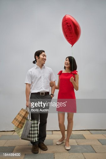 Couple with shopping bags and balloon : Stock Photo