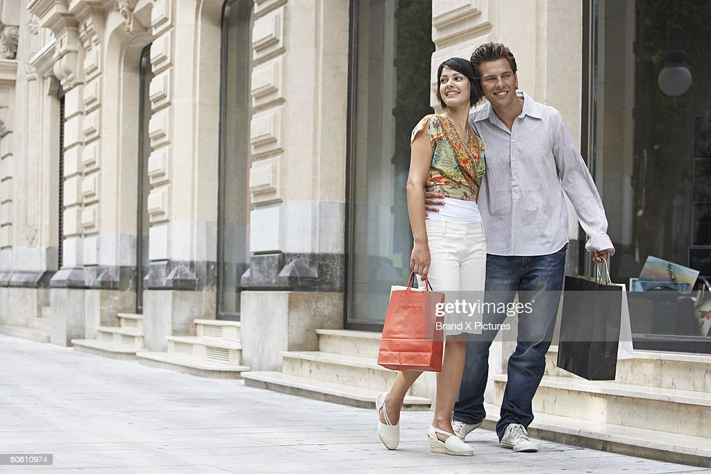 Couple with shopping bags : Stock Photo