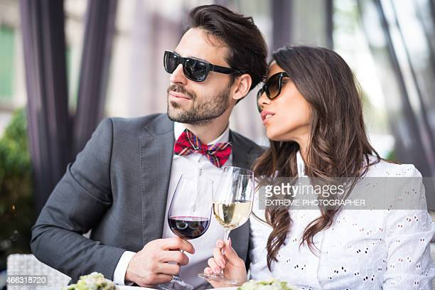 Couple with sunglasses drinking wine