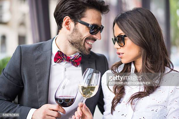 Couple with sunglasses having a toast