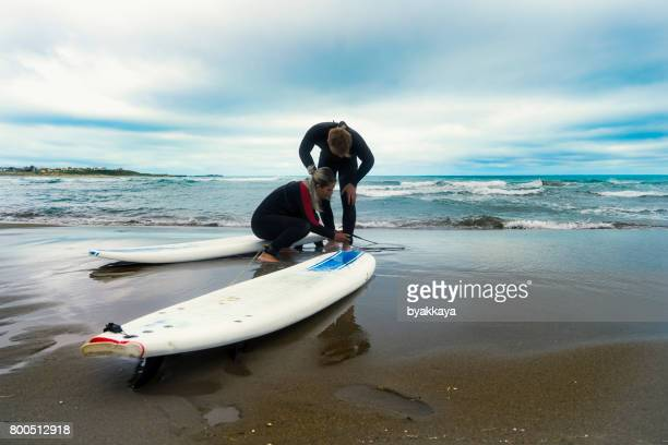 Couple with surfboards