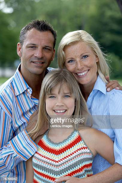 Couple with their daughter.