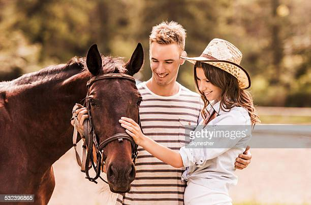 Couple with their horse.