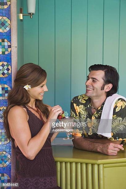 Couple with tropical cocktail