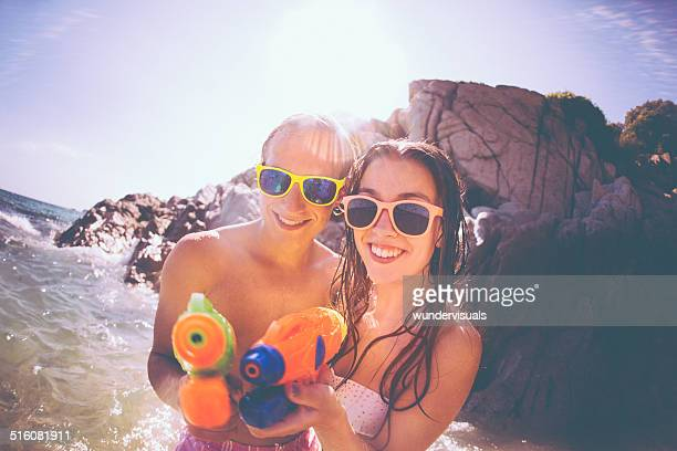 Couple With Water Guns